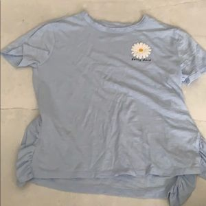 Baby blue shirt with daisy on it